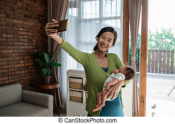 young mother selfie with little daughter