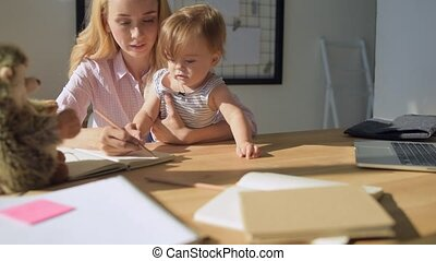 Young mother teaching the child at home
