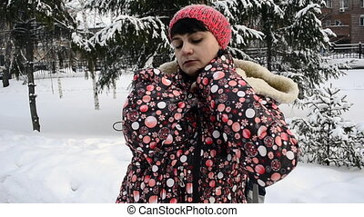 Young mother walking in a winter