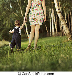 Young mother walking with her child