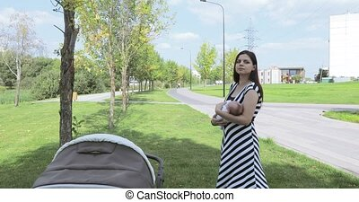 Young mother with baby in park
