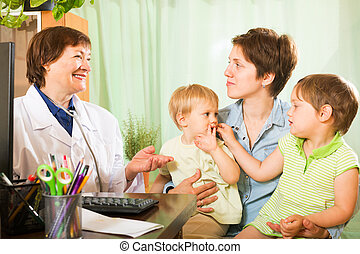 Young mother with  children and  pediatrician doctor