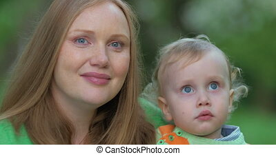 Young mother with cute little child outdoor