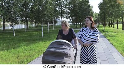 Young mother with her mom in the park