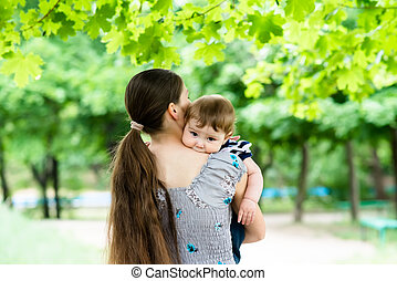 young mother with her son in her arms