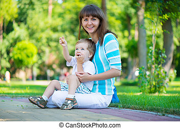 Young mother with her son in park