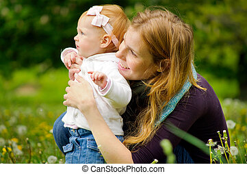 Young mother with little baby at the park