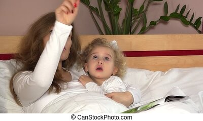 Young mother woman showing stars on ceiling to her adorable child girl