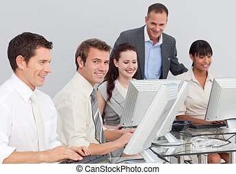 Young multi-ethnic business people working with computers in an office