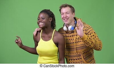 Young multi-ethnic couple smiling together - Studio shot of...
