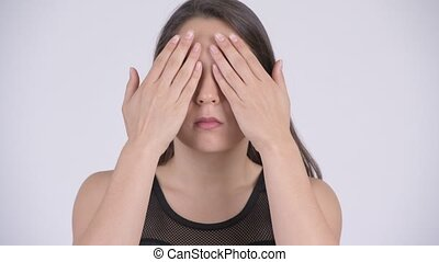Young multi-ethnic woman covering eyes as three wise monkeys...