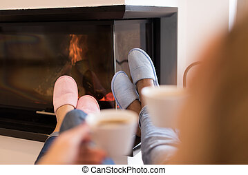 Young multiethnic couple  in front of fireplace