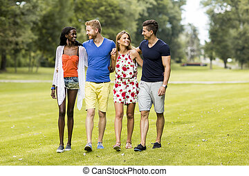 Young multiracial friends in the park