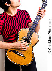 Young multiracial man playing flamenco guitar