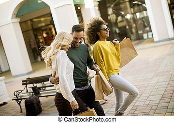 Young multiracial people in shopping