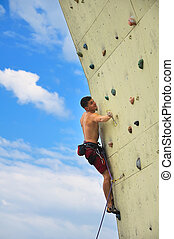 man climbing on a wall