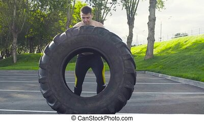 Young muscular man doing crossfit exercises outdoors - Young...