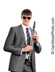 Young musician in sunglasses with clarinet