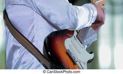 Young Musician Playing Guitar At Wedding