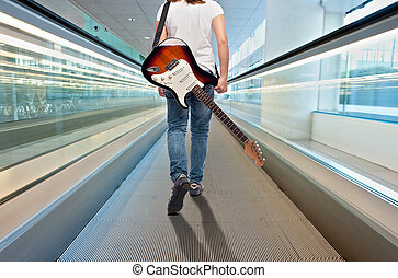 young musician woman with electric guitar
