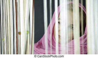 young muslim arabian woman in pink hijab drinks cofee and...