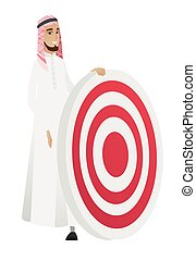 Young muslim businessman and dart board.