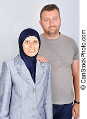 Young muslim couple, standing, isolated, studio