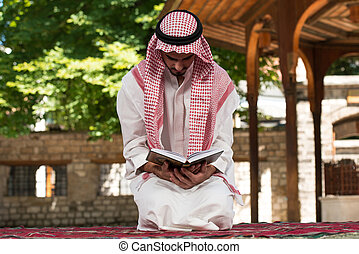 Young Muslim Guy Praying - Young Muslim Man Making...