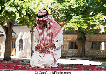 Young Muslim Man Praying - Young Muslim Man Making...