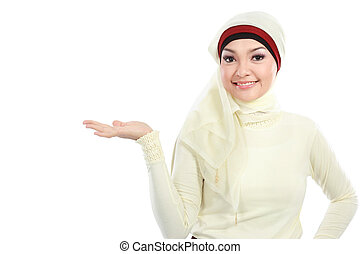 young muslim woman in head scarf presenting isolated over white background