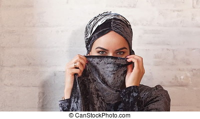 Young muslim woman in head scarf smile. - Young muslim woman...