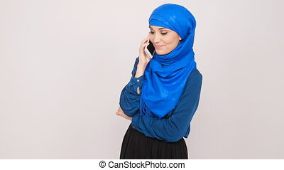Young muslim woman talking on cell phone - Beautiful muslim...