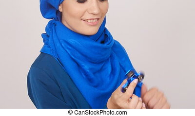 Young muslim Woman with spinner toy - Young muslim Woman...
