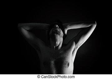 naked man with bandage on eyes