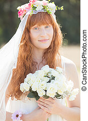 Young natural bride with white veil