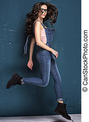 Young natural female model jumping. - Young beautiful girl...