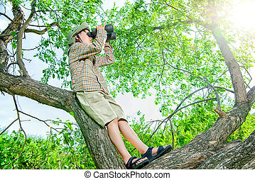 young naturalist on a tree