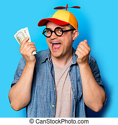 Young nerd man with noob hat holding a money