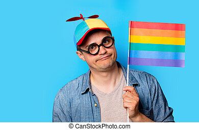 nerd man with noob hat holding a rainbow flag