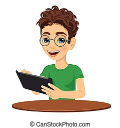 young nerd teenager boy using tablet computer