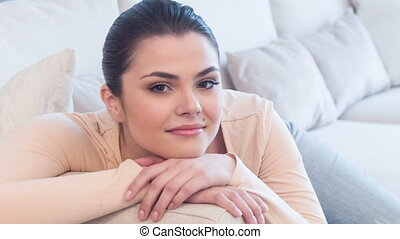 Young net woman sitting on sofa