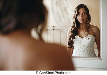 Young Nice Bride Looking in Mirror