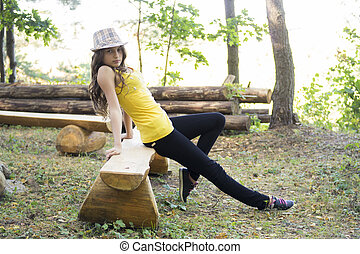 young nice girl posing in the forest