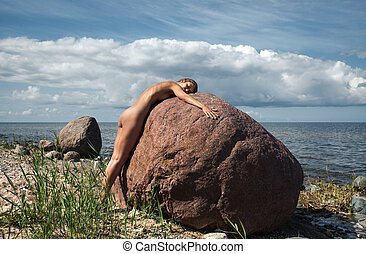 Young nude woman enjoying nature