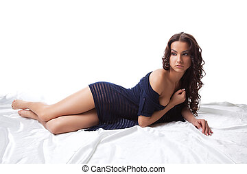 Young nude woman lay on white in knitted jacket