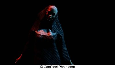 young nun in the dark