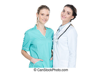 young nurse and doctor smiling and looking at camera isolated on white