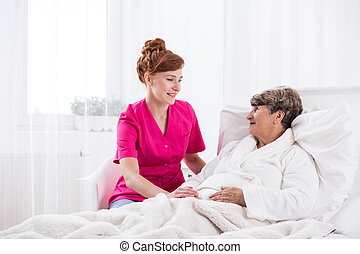 Young nurse and elderly woman