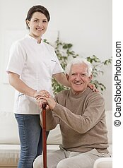 Young nurse and old man - Young nurse caring for old man...