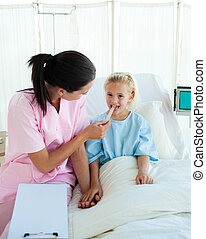 Young nurse attending a child patient